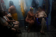 Bolivians enjoy the weekend at the Sauna Sucre, one of the oldest in La Paz, Saturday, April 10, 2010.