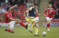 Photo: Aidan Ellis.<br /> Barnsley v Derby County. Coca Cola Championship. 31/03/2007.<br /> Barnsley's Sam Togwell challenges derby's Jon Macken