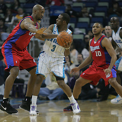 Jan 13, 2010; New Orleans, LA, USA; Los Angeles Clippers center Brian Skinner (8) defends against New Orleans Hornets guard Chris Paul (3) during the first half at the New Orleans Arena. Mandatory Credit: Derick E. Hingle-US PRESSWIRE