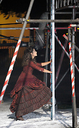 © Licensed to London News Pictures. 21/08/2012. Bristol, UK. Actress Jenna-Louise Coleman on set as the BBC's Dr Who film at night in Bristol's Portland Square.  Jenna-Louise Coleman plays Doctor Who's new companion.  Fake snow was used for a winter scene for Christmas where her character comes out from behind a tree and climbs up a ladder.  21 August 2012..Photo credit : Simon Chapman/LNP