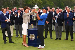 May 19, 2019 - Farmingdale, NY, U.S. - FARMINGDALE, NY - MAY 19: PGA of America President  Suzy Whaley hands Brooks Koepka of the United States the Wanamaker Trophy after winning the 2019 PGA Championship at the Bethpage Black course with a score of 8 under par on May 19, 2019 in Farmingdale, New York.(Photo by Rich Graessle/Icon Sportswire) (Credit Image: © Rich Graessle/Icon SMI via ZUMA Press)