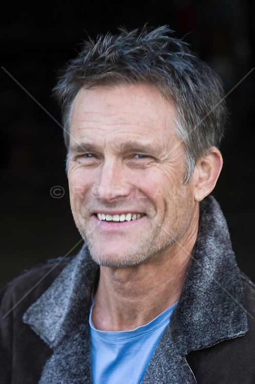 Portrait of a good looking scruffy faced grey haired man