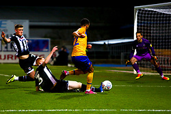 Liam Gibson of Grimsby Town slides in to stop an attack by CJ Hamilton of Mansfield Town - Mandatory by-line: Ryan Crockett/JMP - 04/01/2020 - FOOTBALL - One Call Stadium - Mansfield, England - Mansfield Town v Grimsby Town - Sky Bet League Two