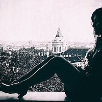 Female sitting with view over city