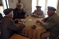 Men in village of Saribelen in Southern Turkey playing games chatting and socialising in bar cafe coffee house.