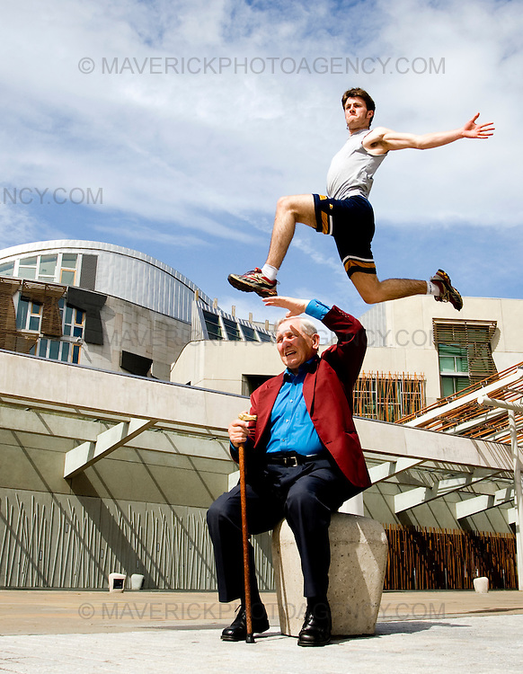 """..John Hall leaps over Jimi King at the Scottish Parliament to launch the new """"Urbathon"""" event to be held in Scotlands capital...HUNDREDS of runners will have the chance to jump, climb and crawl their way through the capital in the first  10 kilometre race of its kind to take place in Scotland which involves obstacle course challenges. ..Picture Michael Hughes/Maverick ."""