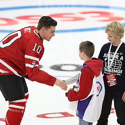 COBOURG, - Dec 13, 2015 -  Game #1 - Czech Republic vs Canada West at the 2015 World Junior A Challenge at the Cobourg Community Centre, ON. Captain Tyson Jost #10 of Team Canada West shakes hands with the two minor hockey players who dropped the puck during the ceremonial face-off. (Photo: Tim Bates / OJHL Images)