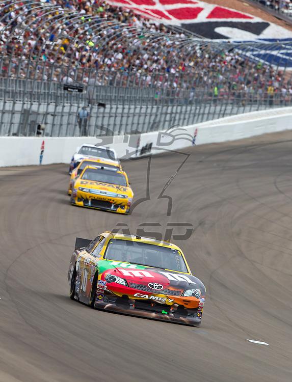 LAS VEGAS, NV - MAR 11, 2012:  Kyle Busch (18) brings his car through the turns during the Kobalt Tools 400 race at the Las Vegas Motor Speedway in Las Vegas, NV.
