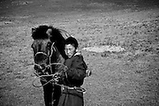 A young boy and his horse near White Lake, North West Mongolia.