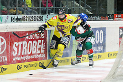 04.01.2015, Curt Frenzel Stadion, Augsburg, GER, DEL, Augsburger Panther vs Krefeld Pinguine, 35. Runde, im Bild l-r: im Zweikampf, Aktion, mit Tyler Beechey #11 (Krefeld Pinguine) und Colton Jobke #42 (Augsburger Panther) // during Germans DEL Icehockey League 35th round match between Augsburger Panther and Krefeld Pinguine at the Curt Frenzel Stadion in Augsburg, Germany on 2015/01/04. EXPA Pictures © 2015, PhotoCredit: EXPA/ Eibner-Pressefoto/ Kolbert<br /> <br /> *****ATTENTION - OUT of GER*****