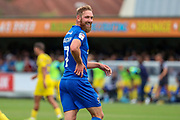 AFC Wimbledon midfielder Scott Wagstaff (7) looking into crowd and smiling during the EFL Sky Bet League 1 match between AFC Wimbledon and Wycombe Wanderers at the Cherry Red Records Stadium, Kingston, England on 31 August 2019.