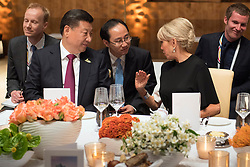 July 7, 2017 - Hamburg, Germany - Brigitte Macron, wife of French President Emmanuel Macron, right, chats with Chinese President Xi Jinping during a dinner for world leaders attending the first day of the G20 Summit meeting at the Elbphilharmonie concert hall July 7, 2017 in Hamburg, Germany. (Credit Image: © Guido Bergmann/Planet Pix via ZUMA Wire)