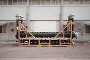 A pallet of plastic piping is waiting for shipping