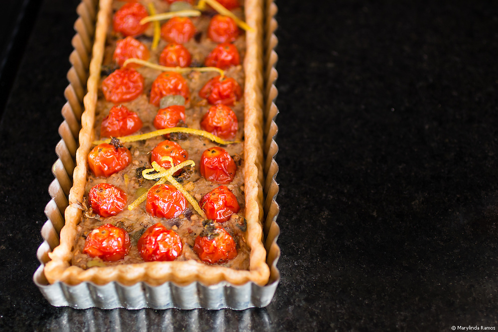 Pureed eggplant caponata, grape tomatoes seasoned with plenty of oregano, and a savory pastry crust make this autumn treat interesting enough to serve as an appetizer or a light lunch.
