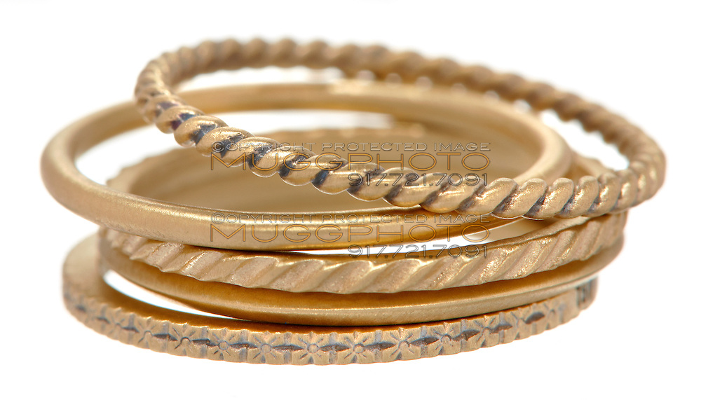 Gold rings on white background