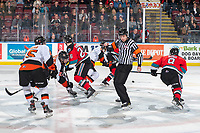 KELOWNA, BC - NOVEMBER 8: Referee Jeff Ingram dodges the puck after the face-off between the Kelowna Rockets and the Medicine Hat Tigers at Prospera Place on November 8, 2019 in Kelowna, Canada. (Photo by Marissa Baecker/Shoot the Breeze)