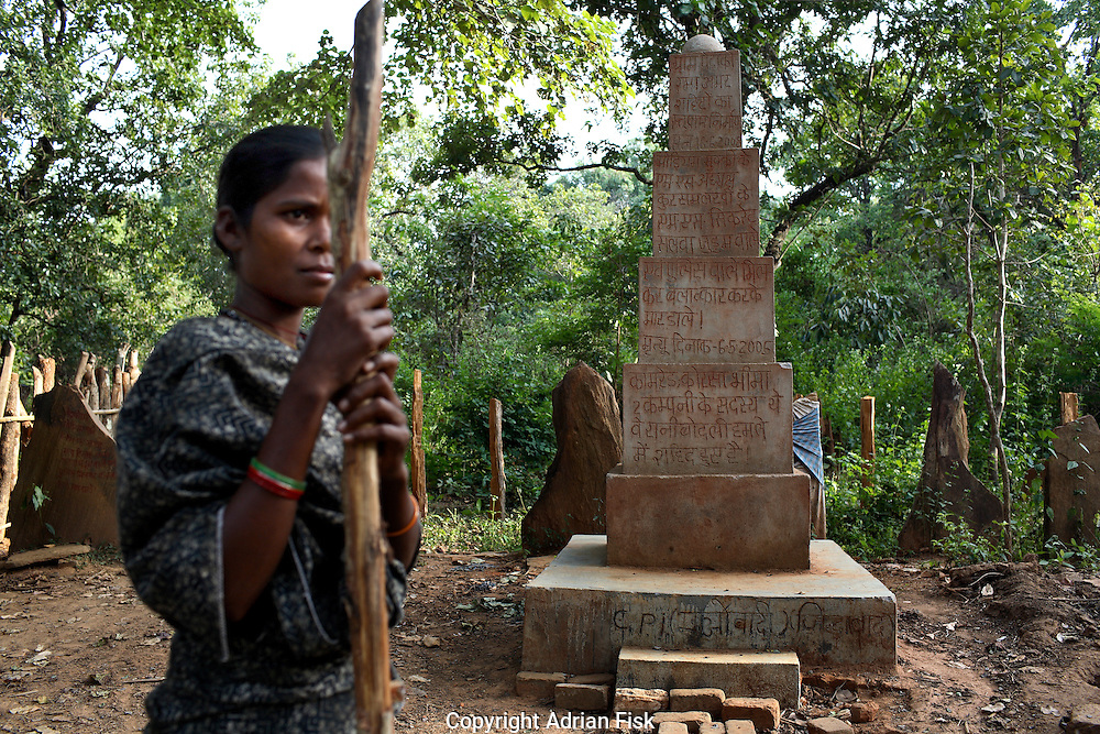 In the district of Bastar six hours walk into the jungle a Naxalite Maoist memorial sits. The hindi script honours three Naxalite women who it says were raped and killed by the Salwa Judam militia and police. It says 'The martyrdom will not be in vain' and 'Long live the people's guerilla army'.