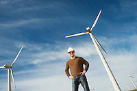 Engineer wearing hardhat at wind farm, portrait
