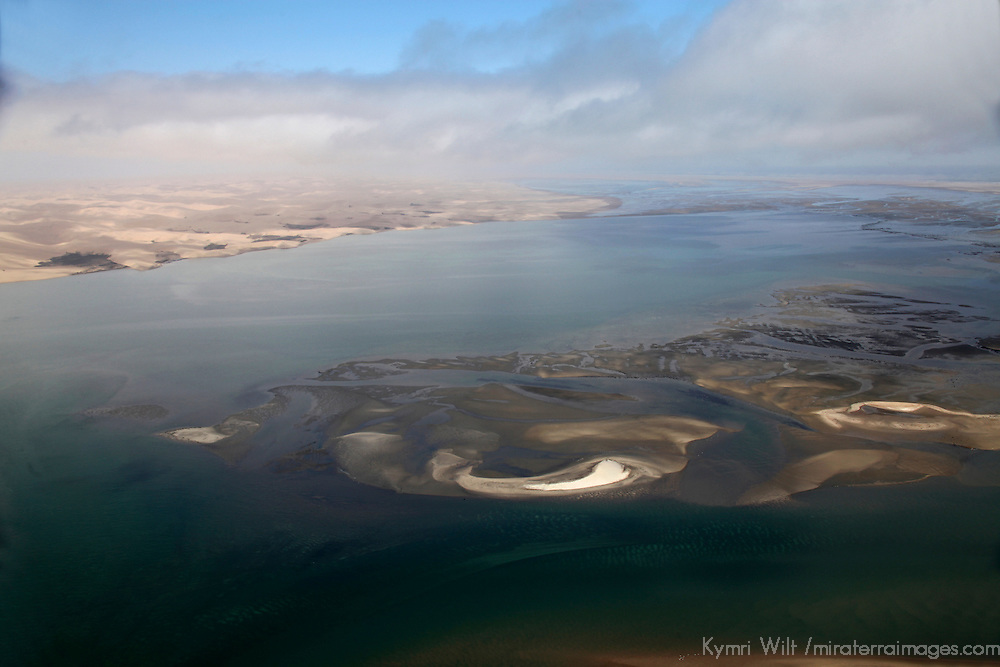 Africa, Namibia, Walvis Bay. Aerial view of Namib Rand Desert coast, where the desert meets the sea.