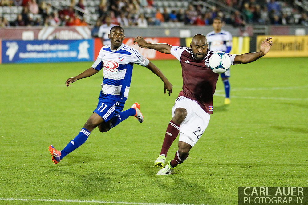 September 14th, 2013 -  Colorado Rapids defender Marvell Wynne (22) keeps the ball away from the rushing FC Dallas forward Fabian Castillo (11) in second half action of the MLS Soccer game between FC Dallas and the Colorado Rapids at Dick's Sporting Goods Park in Commerce City, CO
