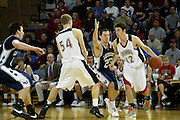 John Grotberg '11 dribbles around a Lawrence defender as Kale Knisley '11 sets a pick during the Midwest Conference Championship game in Darby Gymnasium.