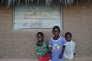 Africa. Malawi. Ruare. Hiking along the lake shore. Children by sign promoting human rights and democracy..CD001