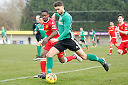 Burgess Hill midfielder Jack Brivio has a shot on goal during the Ryman Premier League match between Merstham and Burgess Hill at Moatside, Merstham, United Kingdom on 31 December 2016. Photo by Andy Walter.