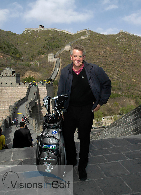 19 April 2005. Johnnie Walker Classic, Pine Valley Golf Club, Beijing, China. Colin Montgomerie poses for a photo on the Great Wall of China<br />