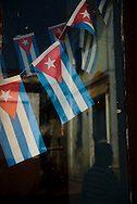 Small flags on a window at Cienfuegos