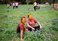 Jugaly Gaba, left, and Bharat Halderia pose for a photo among a field of Bluebonnets during celebrations to mark Holi, the Hindu festival of colors on Saturday, March 23, 2019, in Austin, Texas. Holi, the riotous annual celebration of color, marks the end of winter and the arrival of spring. [NICK WAGNER/AMERICAN-STATESMAN]