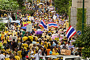 "22 JUNE 2011 - BANGKOK, THAILAND: Thai Yellow Shirts close Sukhumvit Rd, one of Bangkok's main streets, and call for a no vote during a pre-election rally in Bangkok on Wednesday, June 22. The PAD (People's Alliance for Democracy) or Yellow Shirts, as they are popularly called, has called for a ""No"" vote in Thailand's national election, scheduled for July 3. PAD leadership hopes the no vote will negate the vote of Yingluck Shinawatra, leader of the Pheua Thai party. Yingluck is the youngest sister of exiled former Prime Minister Thaksin Shinawatra, deposed by a military coup in 2006. Yingluck is currently leading in opinion polls, running well ahead of incumbent Prime Minister Abhisit Vejjajiva, head of the Democrat party, which in one form or another has ruled Thailand for most of the last 60 years.     Photo by Jack Kurtz"