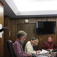 Monroe County Airport Manager Wes Kirkpatrick, left, discusses improvements to the board of supervisors Friday.