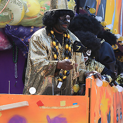 24 February 2009: Scenes from the Krewe of Zulu parade as it rolled along the St. Charles Avenue parade route throwing beads, painted coconuts and various trinkets on Mardi Gras day in New Orleans, Louisiana. Mardi Gras is an annual celebration that ends at midnight with the start of the Catholic Lenten season which begins with Ash Wednesday and ends with Easter..