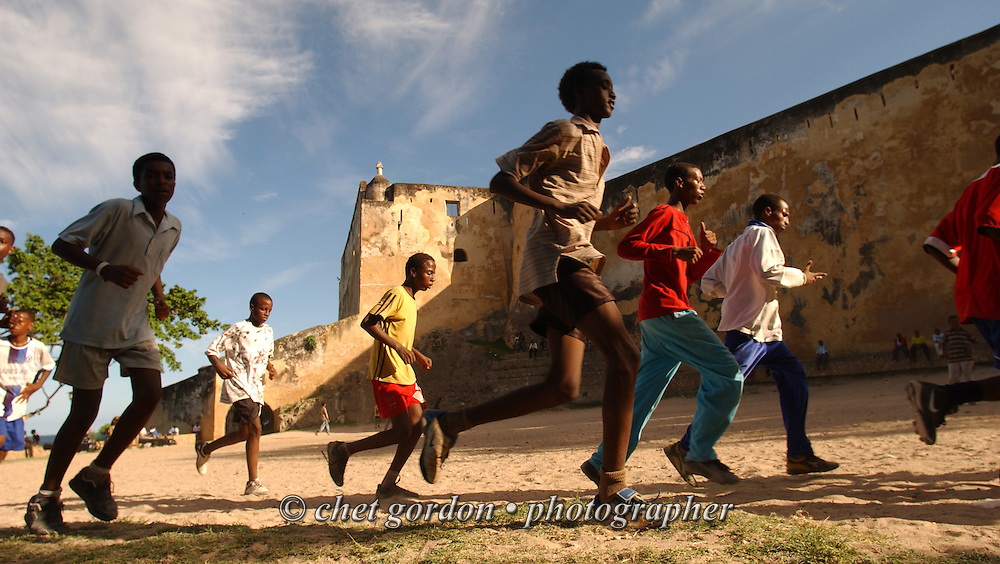Young Kenyan soccer players warm up on the grounds of Fort Jesus in the Old Town neighborhood of Mombasa, Kenya on Sunday, April 16, 2006.