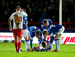 STEVENAGE, ENGLAND - Saturday, January 25, 2014: Everton players attend to injured team-mate Bryan Oviedo during the FA Cup 4th Round match against Stevenage at Broadhall Way. (Pic by Tom Hevezi/Propaganda)