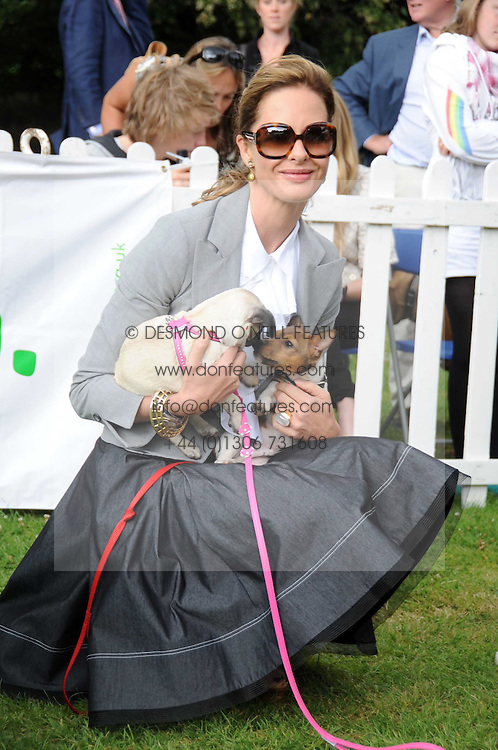 TRINNY WOODALL and puppies at the Macmillan Dog Day in aid of Macmillan Cancer Support held at the Royal Hospital Chelsea, London on 8th July 2008.<br />