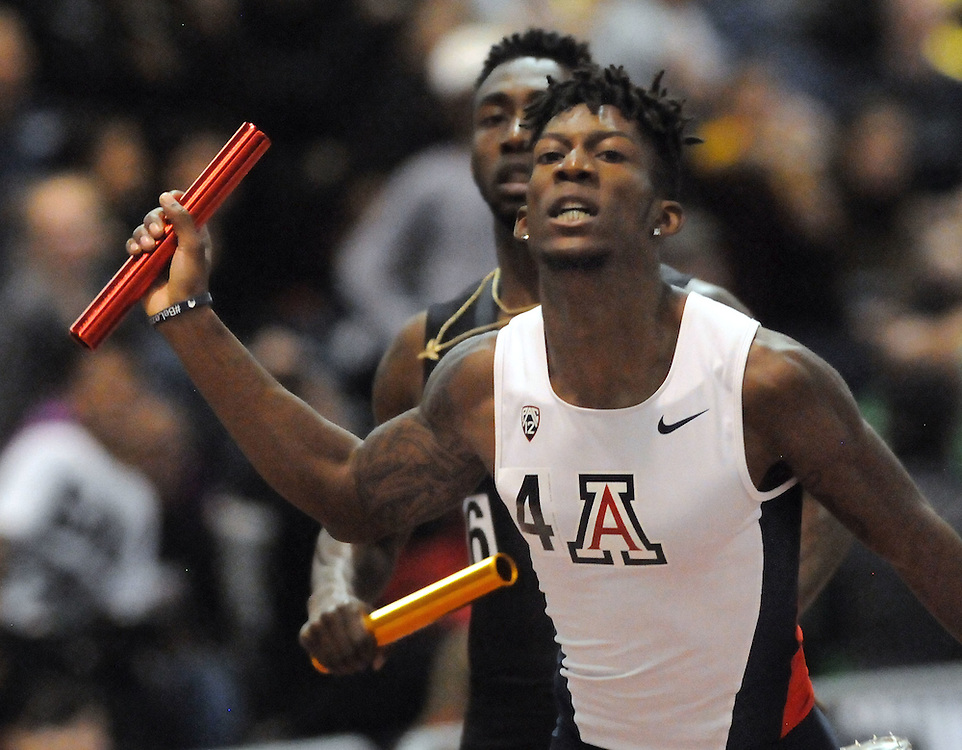 jt021117j/sports/jim thompson/ Arizona's Michael Demby finished just in front of ASU's Drelan Bramwell in the 4x400 relay at the Don Kirby Indoor Track Meet.  Saturday Feb.11, 2017. (Jim Thompson/Albuquerque Journal)