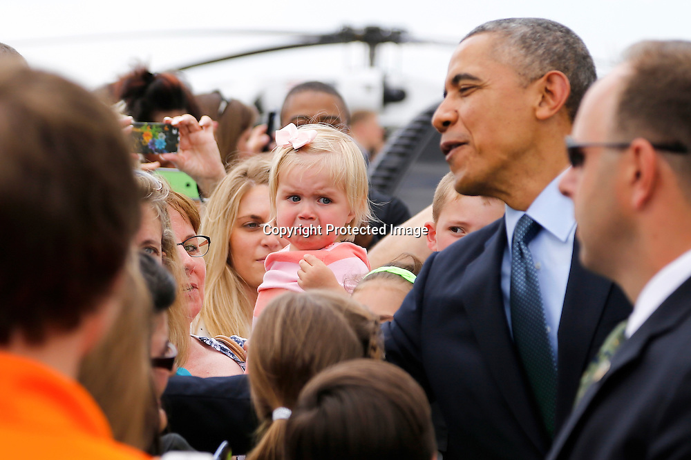 U.S. President Barack Obama greets onlookers as after arriving via Air Force One at O'Hare Airport in Chicago, May 23, 2014.