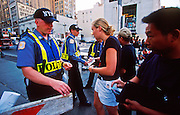 NEW YORK, NY: New York city police cadets check the identification of people trying to go below Canal Street towards the World Trade Center, Sept 19, 2001. NY police shut down lower Manhattan after terrorists crashed two hijacked jetliners into the WTC towers on Sept 11, 2001, killing more 2,900 people.   PHOTO BY JACK KURTZ