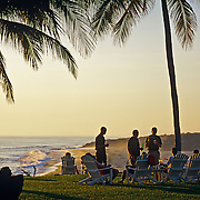 Friends enjoying the sunset in hotel garden. Puerto Escondido. Oaxaca, Mexico.