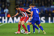 Leicester City midfielder Danny Drinkwater (4) and Leicester City midfielder Marc Albrighton (11) put pressure on Atletico Madrid midfielder Saul Niguez (8) during the Champions League quarter final match 2 between Leicester City and Atletico Madrid at the King Power Stadium, Leicester, England on 18 April 2017. Photo by Jon Hobley.