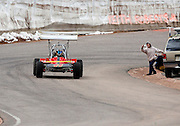 COLORADO SPRINGS - JUNE 27:  A fan tries to take a photograph as Dave Wood #11 drives a 2010 Wells Jerr Bear SPC in the Open Wheel Division as he races 12.42 miles up to the 14,110 foot summit of Pikes Peak Mountain in Pike National Forest during the 88th running of the Pikes Peak International Hill Climb, the second oldest motor sports event in the United States, on June 27, 2010 in Colorado Springs, Colorado. ©Paul Anthony Spinelli