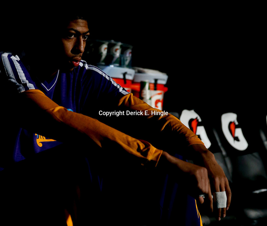 Feb 6, 2013; New Orleans, LA, USA; New Orleans Hornets power forward Anthony Davis (23) sits on the bench prior to tip off of a game against the Phoenix Suns at the New Orleans Arena. The Hornets defeated the Suns 93-84. Mandatory Credit: Derick E. Hingle-USA TODAY Sports