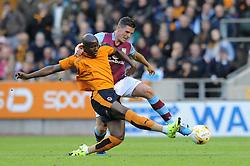 Ciaran Clark of Aston Villa tackles Benik Afobe of Wolves - Mandatory by-line: Dougie Allward/JMP - 07966386802 - 28/07/2015 - SPORT - FOOTBALL - Wolverhampton,England - Molineux Stadium - Wolves v Aston Villa - Pre-Season Friendly