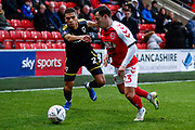 Wimbledon defender Tennai Watson (2), on loan from Reading, takes on Fleetwood Town midfielder Ross Wallace (23)   during the The FA Cup 3rd round match between Fleetwood Town and AFC Wimbledon at the Highbury Stadium, Fleetwood, England on 5 January 2019.