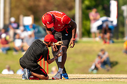 September 22, 2018 - Morrisville, North Carolina, US - Sept. 22, 2018 - Morrisville N.C., USA - Team Canada DILON HEYLIGER (20) is attended by a trainer during the ICC World T20 America's ''A'' Qualifier cricket match between USA and Canada. Both teams played to a 140/8 tie with Canada winning the Super Over for the overall win. In addition to USA and Canada, the ICC World T20 America's ''A'' Qualifier also features Belize and Panama in the six-day tournament that ends Sept. 26. (Credit Image: © Timothy L. Hale/ZUMA Wire)
