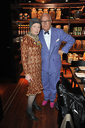 DAME VIVIENNE WESTWOOD and MANOLO BLAHNIK at a dinner in honour of Andre Leon Talley and Manolo Blahnik held at The Spice Market restaurant at W London, Leicester Square, London on 14th March 2011.