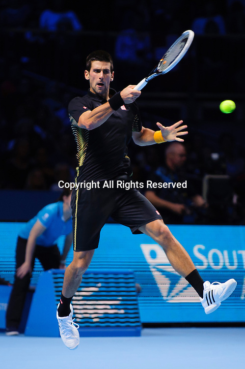 12.11.2012 London, England. Serbias Novak Djokovic in action against Switzerlands Roger Federer during the Final of the Barclays ATP World Tour Finals at The O2 Arena. Djokovic goes on to win the match in straight sets.