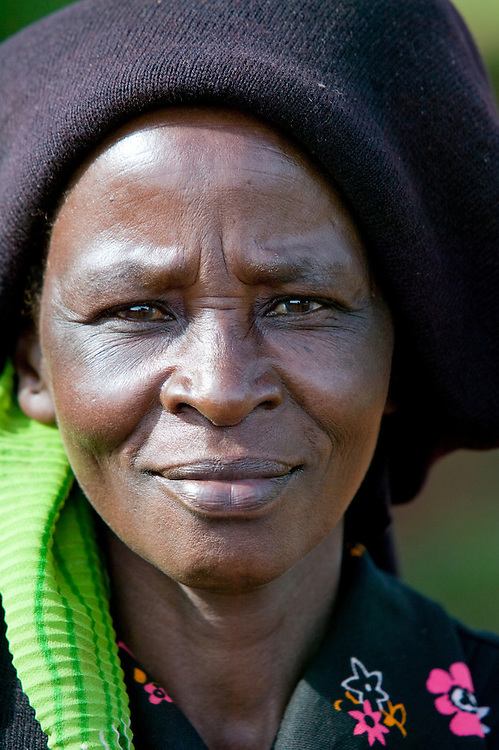 Africa, Kenya, Ruira, Portrait of woman  during harvest of  Arabica coffee beans at Oakland Estates plantation