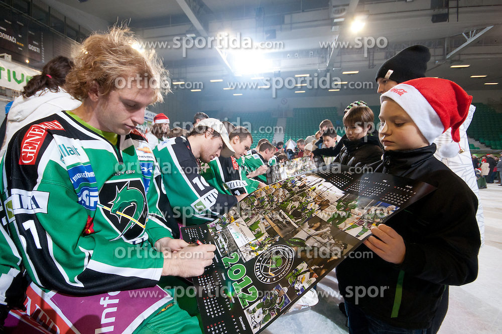 Santa Clause for kids after ice-hockey match between HDD Tilia Olimpija and EHC LIWEST Linz in 35th Round of EBEL league, on December 30, 2011 at Hala Tivoli, Ljubljana, Slovenia. (Photo By Matic Klansek Velej / Sportida)
